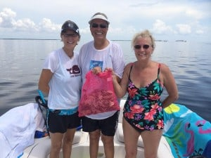 3 people scalloping